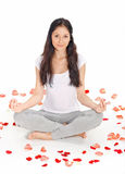 Young beautiful woman meditating in lotus pose Stock Photo
