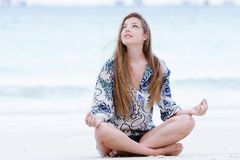 Young beautiful woman meditating on nature Stock Photos