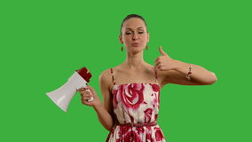 Young beautiful woman with  megaphone  on a green screen. 22 stock footage