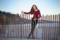 Young beautiful woman with messy long hair on windy day outdoor on the shore beach Royalty Free Stock Photography