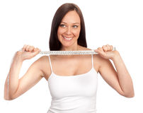 Young beautiful woman by a meter ribbon Royalty Free Stock Photography