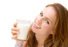 Young beautiful woman with milk Royalty Free Stock Images