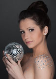Young beautiful woman with mirrored ball Royalty Free Stock Images