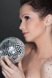 Young beautiful woman with mirrored ball Stock Images