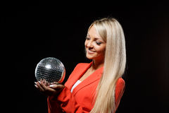 Young beautiful woman with mirrored ball. Royalty Free Stock Photo