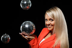 Young beautiful woman with mirrored ball. Stock Photography