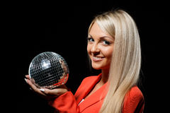 Young beautiful woman with mirrored ball. Royalty Free Stock Photos