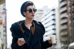 Young beautiful woman with mobile phone and coffee. Royalty Free Stock Photo