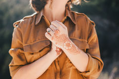 Young beautiful woman in a modern dress with mehendi posing among mountains Royalty Free Stock Image