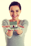 Young beautiful woman with money and house . Young beautiful woman with money and house Stock Photography