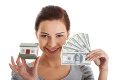 Young beautiful woman with money and house . Stock Photography