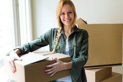 Young beautiful woman moving in a new home. Stock Image