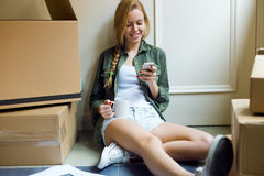 Young beautiful woman moving in new home. Royalty Free Stock Photography