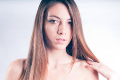 Young beautiful woman with naked shoulders Royalty Free Stock Images