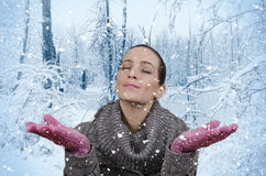 Snow. Young beautiful woman in nature when it snows Royalty Free Stock Photo