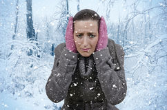 Snow. Young beautiful woman in nature when it snows Stock Image