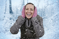 Snow. Young beautiful woman in nature when it snows Royalty Free Stock Image