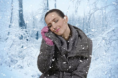 Snow. Young beautiful woman in nature when it snows Stock Photo