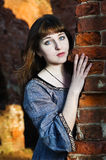 Young beautiful woman near brick wall Stock Photos