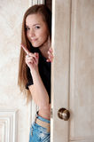 Young beautiful woman near the door Royalty Free Stock Image