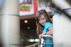 Young beautiful woman near a handrail Royalty Free Stock Photos