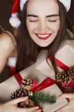 Young beautiful woman near new year tree Stock Images