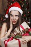 Young beautiful woman near new year tree Royalty Free Stock Photo