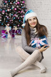 Young beautiful woman near new year tree Royalty Free Stock Images