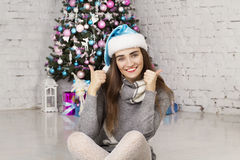 Young beautiful woman near new year tree Royalty Free Stock Photography