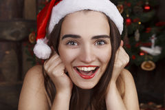 Young beautiful woman near new year tree Stock Photo