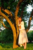 Young beautiful woman next to apple tree Stock Photo