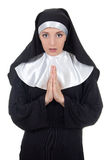 Young beautiful woman nun praying isolated on white Royalty Free Stock Image