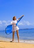 The young beautiful woman on an ocean coast. Stock Photo