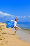 The young beautiful woman on an ocean coast. Stock Photography