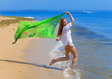 The young beautiful woman on an ocean coast. Royalty Free Stock Photography
