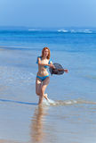 The young beautiful woman on an ocean coast. Royalty Free Stock Photos