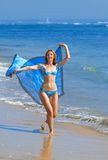 The young beautiful woman on an ocean coast. Indon Royalty Free Stock Image