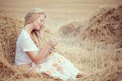 Young Beautiful Woman On Field Stock Photo