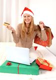 Young beautiful woman online Christmas shopping Royalty Free Stock Images