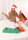 Young beautiful woman online Christmas shopping Stock Photos