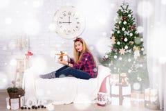Young beautiful woman opening Christmas gift box Stock Photos