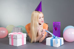 Young beautiful woman opening the gift Stock Images