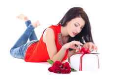 Young beautiful woman opening gift box isolated on white Stock Images