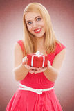 Young beautiful woman opening a gift box Royalty Free Stock Image
