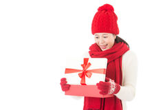 Young beautiful woman opening gift surprised and happy Royalty Free Stock Photo