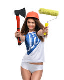 Young beautiful woman in orange construction safety hat show axe Stock Images