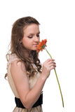 Young beautiful woman with  orange flower Stock Photos