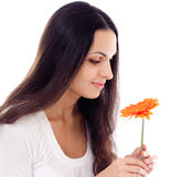Young beautiful woman with orange flower  isolated Stock Photo