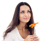 Young beautiful woman with orange flower isolated Stock Image