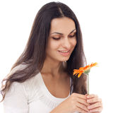 Young beautiful woman with orange flower isolated Stock Photos